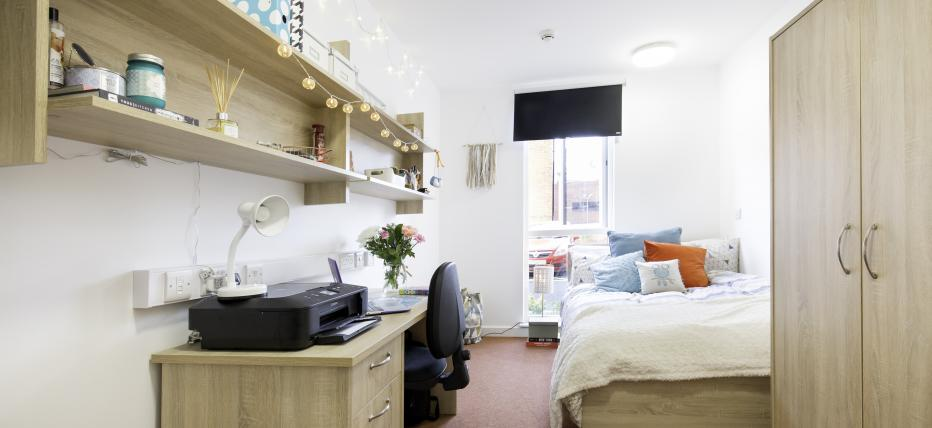 Bedroom, bed, cupboard, desk, chair, lamp and shelves
