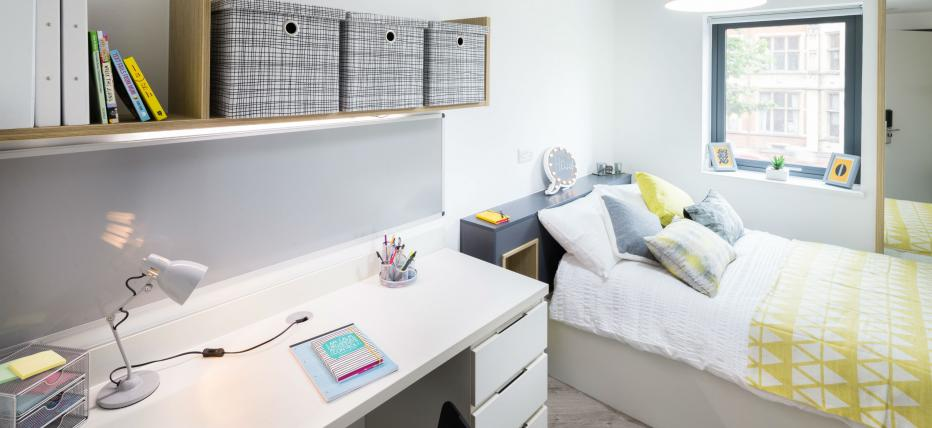 Bed, desk area with chair