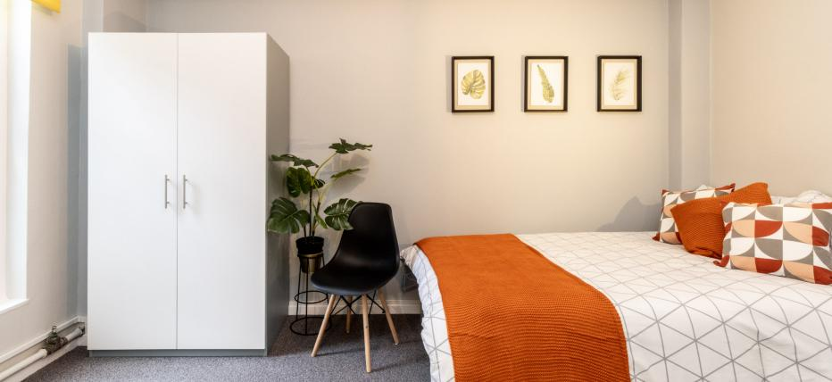 Bedroom with small double bed and wardrobe