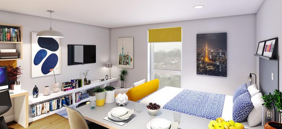 Bed, sofa with tv on wall and kitchen area