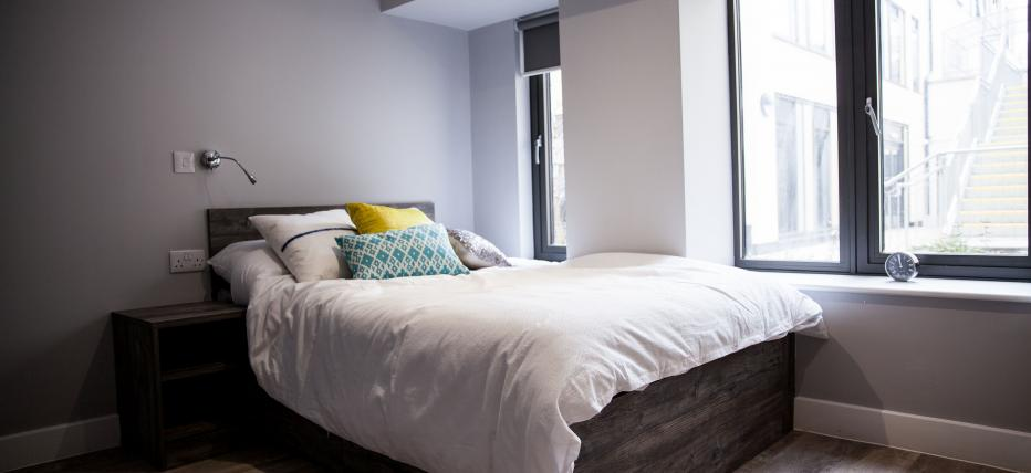 Bedroom with bed and large windows