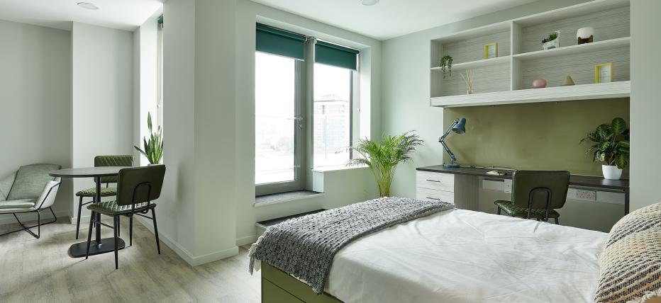 Bed, desk area with chair. Dining table. Door to terrace