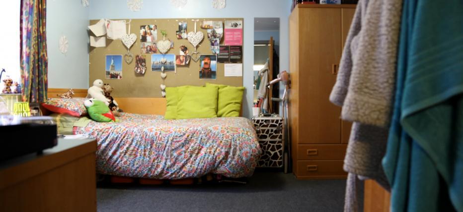 Adapted bedroom, bed, mirror, wardrobe, noticeboard, desk and window