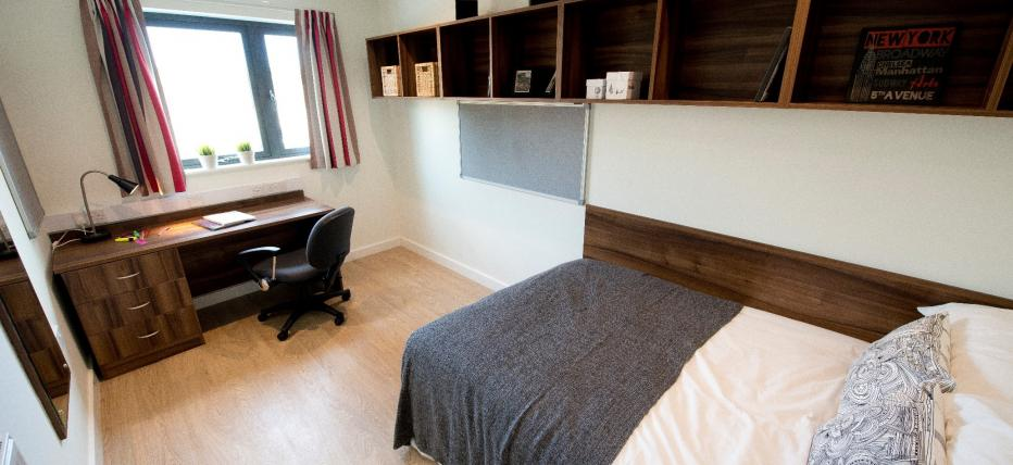 Premium En-suite - Bed, shelving and desk area with chair