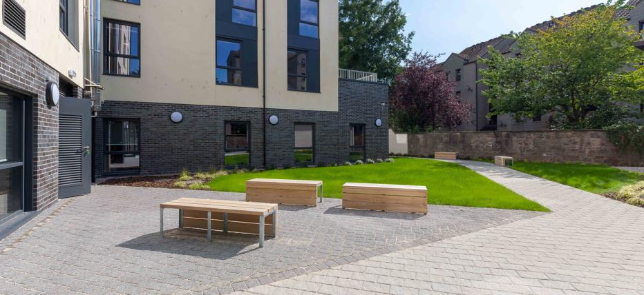 Exterior image, building, windows, benches, trees, outdoor area