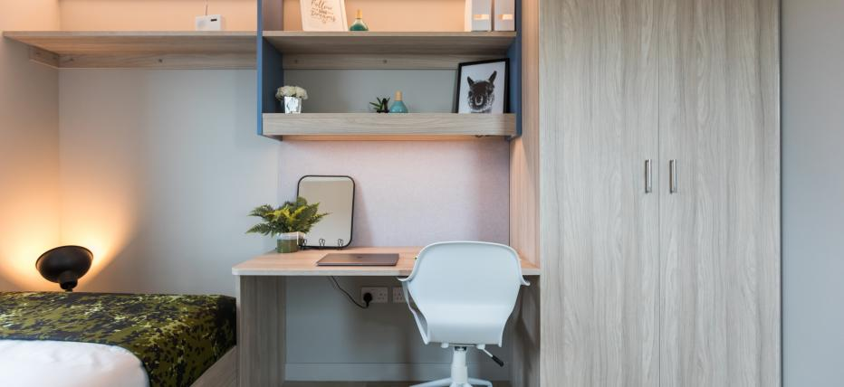 Desk area with chair and Wardrobe