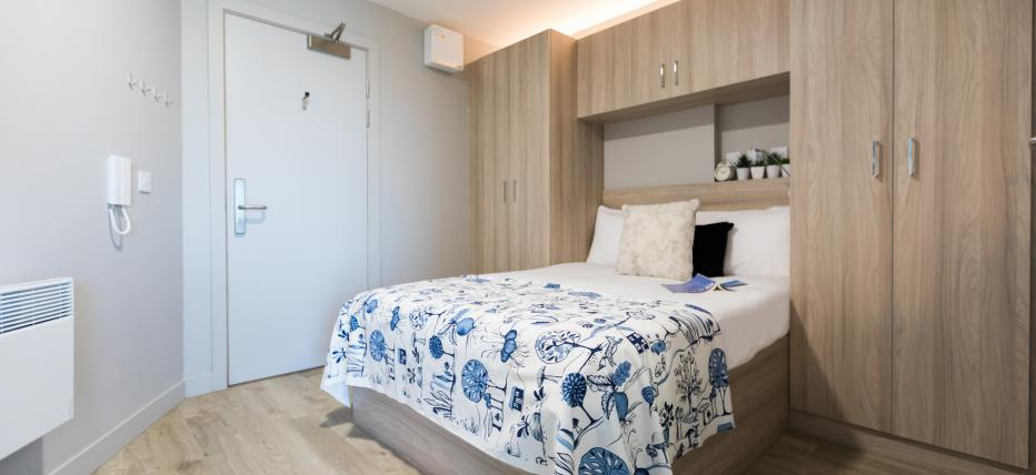 Bed with wardrobes