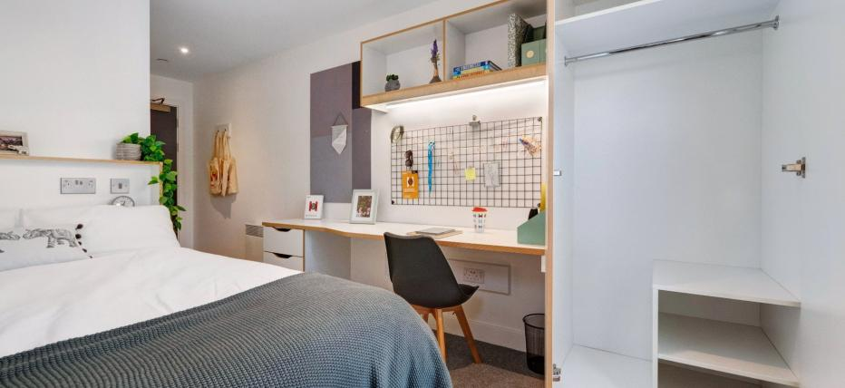 Bed, desk, chair and wardrobe