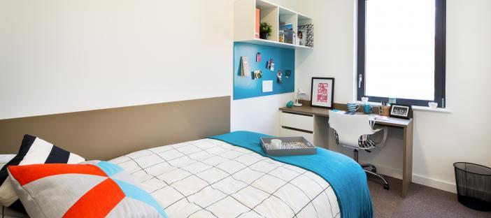 Bed, window, desk, noticeboard and shelves