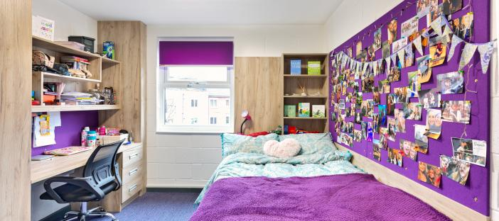 Bed, large noticeboard, desk, 2 wardrobes, chair and window