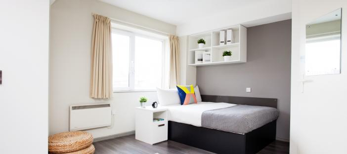 Classic Studio - Bed with shelving above, bedside table and wardrobe