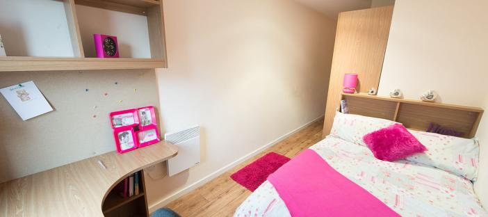 Bedroom, bed, desk, shelves, chair, wardrobe