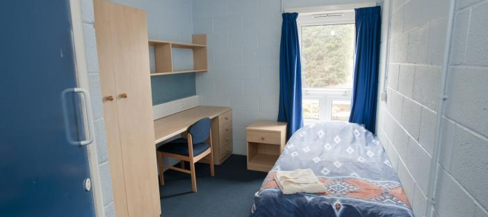 Bedroom with bed, wardrobe and desk