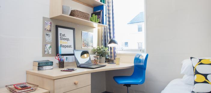 Bedroom, desk, blue chair, window, shelves, single bed, noticeboard