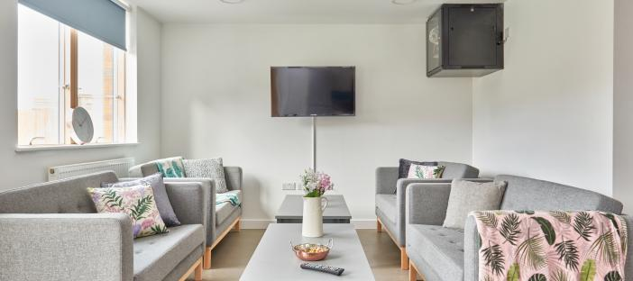 Kitchen, lounge, grey sofas, TV wall mounted, window, coffee tables