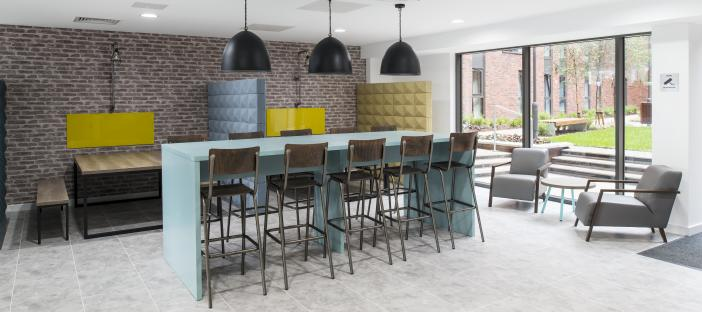 Common Room - Bar with stools and a range of tables and chairs/benches